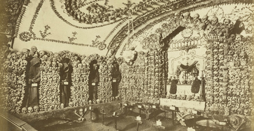 photograph of skulls and crosses inside a convent